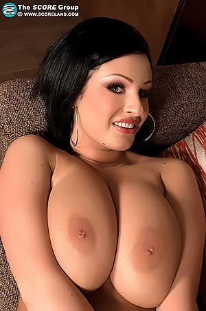 LaTaya Roxx leans back on the sofa