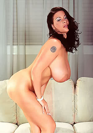 Linsey Dawn Mckenzie bends forward