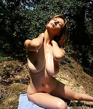 Mature redhead in the woods