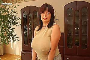 Anyone know who this busty milf is?